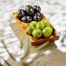 Small dish of green and black olives