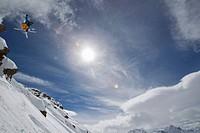 Austria, Tirol, Young man doing freeride skiing
