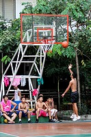BOYS PLAYING BASKETBALL IN A SCHOOL, BANGKOK, THAILAND, ASIA