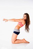 Young woman exercising on white background