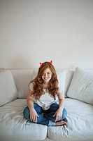 Young woman with devil horn