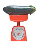 Kitchen scale weighting eggplant