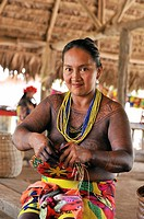 woman weaving basket, Embera native community living by the Chagres River within the Chagres National Park, Republic of Panama, Central America