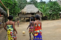 young girls playing football on a village´s square of Embera native community living by the Chagres River within the Chagres National Park, Republic o...