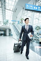 a businessman watching with a luggage in a Incheon airport