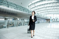 a businesswoman walking with luggage in Incheon airport