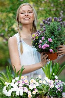 Smiling young woman in garden