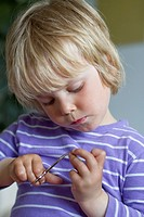 Toddler with nail scissors
