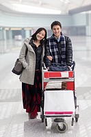Young couple in airport going to travel