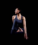 Beautiful yong woman sit in dark _ yoga asana