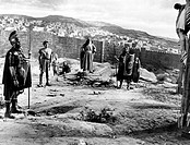 The American actor Victor Mature (Vittorio Maturi) watching Jesus Christ crucifixion in the film The Robe. Two Roman soldiers are keeping guard over. ...