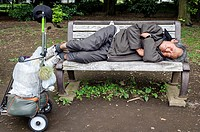 Homeless sleeping on a bench, Yoyogi park, Tokyo, Japan, Asia