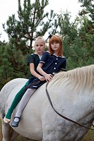 Two girls on a horse