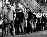 Italian actor Bud Spencer (Carlo Pedersoli) standing in a queue for food in a scene of the film Even Angels Eat Beans. Rome, 1973. Even Angels Eat Bea...