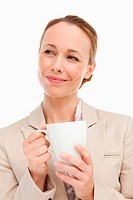 Woman in a suit holding a mug