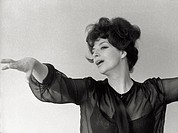 The Italian singer Katyna Ranieri singing during a photo session. 1962.