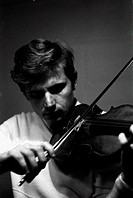 Italian violinist Uto Ughi (Diodato Emilio Ughi) playing the violin. Val Badia, January 1970.