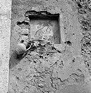 A votive aedicule decorated with the painting of a Madonna with Child. Taormina, 1955.