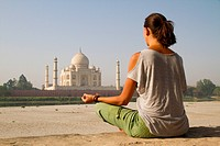 woman meditating at Taj Mahal, India