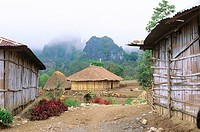 Nenas traditional highland village of indigenous Atoni people perched on a razorback ridge below rugged limestone mountains, East Nusa Tenggara Provin...