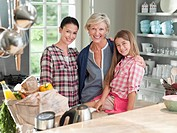 Three generations of women in kitchen