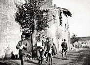 Italian officers walking in the street. San Martino del Carso, 1916