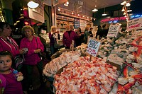 Fishmongers sell seafood at the Pike Place Market in downtown Seattle, Washington, United States