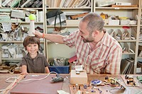 Father and son playing in workshop