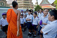 A Buddhist Monk Talking To Thai Schoolchildren , Wat Pho Temple of the Reclining Buddha Bangkok , Thailand