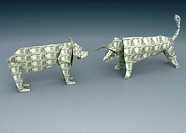 Paper figures of bear and bull head to head