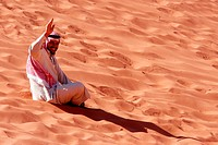 WADI RUM_NOV 10: Jordanian man wearing red Keffiyeh in Wadi Rum,Jordan on November 10 2007 It has been used by arabs throughout the centuries and was ...