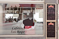 Broken window at the scene of a break in at a cafe where thieves targeted the slot machine. Blood spots on the glass. Los Roques, tenerife, Canary Isl...