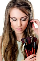 The beautiful girl with brushes for make_up