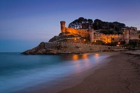 View at dusk of Vila Vella, the medieval old town of Tossa del Mar, Costa Brava, Catalonia, Spain