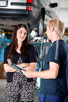 Female Customer in Mechanic Shop