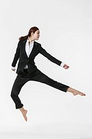 Dynamic pose of a woman dressed in suits