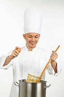 Asian chef preparing noodles