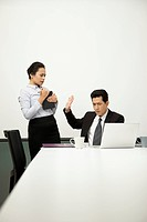 Businessman and businesswoman having discussion in meeting room