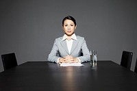 Mid adult businesswoman in meeting room