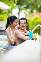 Couple having fun in pool