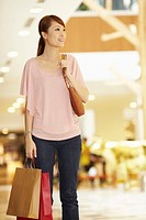Woman carrying shopping items