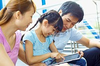 Family using digital tablet together