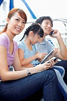 Family using different electronic devices