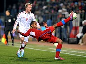 Danish player Michael Kronh-Dehli (left) and Czech Republic's player Theodor Gebre Selassie fight for the ball in their 2014 World Cup qualifying socc...