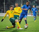 Lithuanian players Saulisu Mikoliunas, left, and Darvydas Sernas, centre, fight for the ball with Dusan Svento, right, of the Slovak team in their 201...