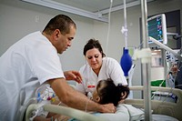 Reportage in Robert Ballanger hospital's Intensive Care Unit in France. A nurse and a student nurse look after a patient.