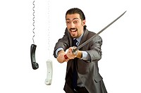 Angry businessman cutting the phone cable