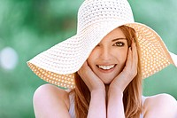 smiling beautiful young woman in summer cap