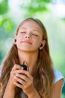 teenage girl with headphones listening to music
