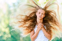 smiling beautiful teenage wind with flying hair